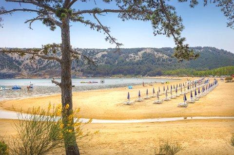 Családi vakáció Lopar homokos tengerpartján