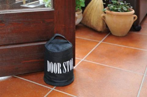 Block ajtótámasztó hordozó füllel, töltet nélkül